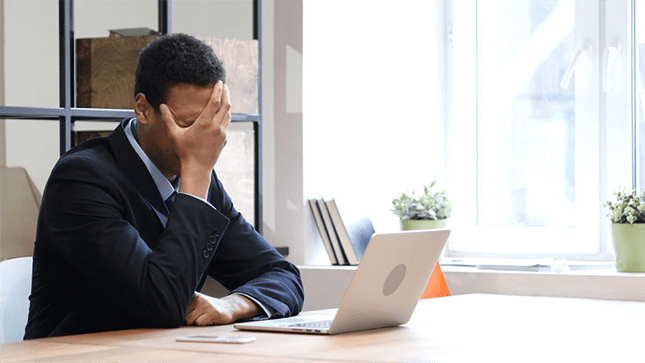 man sad while working on computer