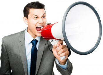 businessman shouting on the megaphone